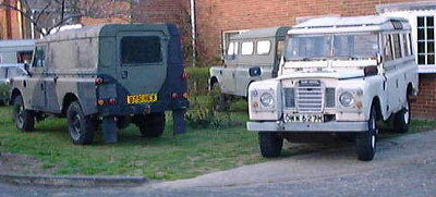 Three Series 3 109in Land Rovers: Two military FFRs and a white 109 Station Wagon